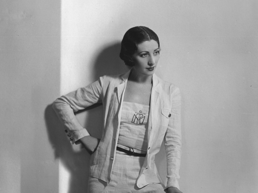 circa 1925: A woman modelling a white linen sailor style trouser suit with wide trouser legs and matching jacket. (Photo by Luigi Diaz/General Photographic Agency/Getty Images)