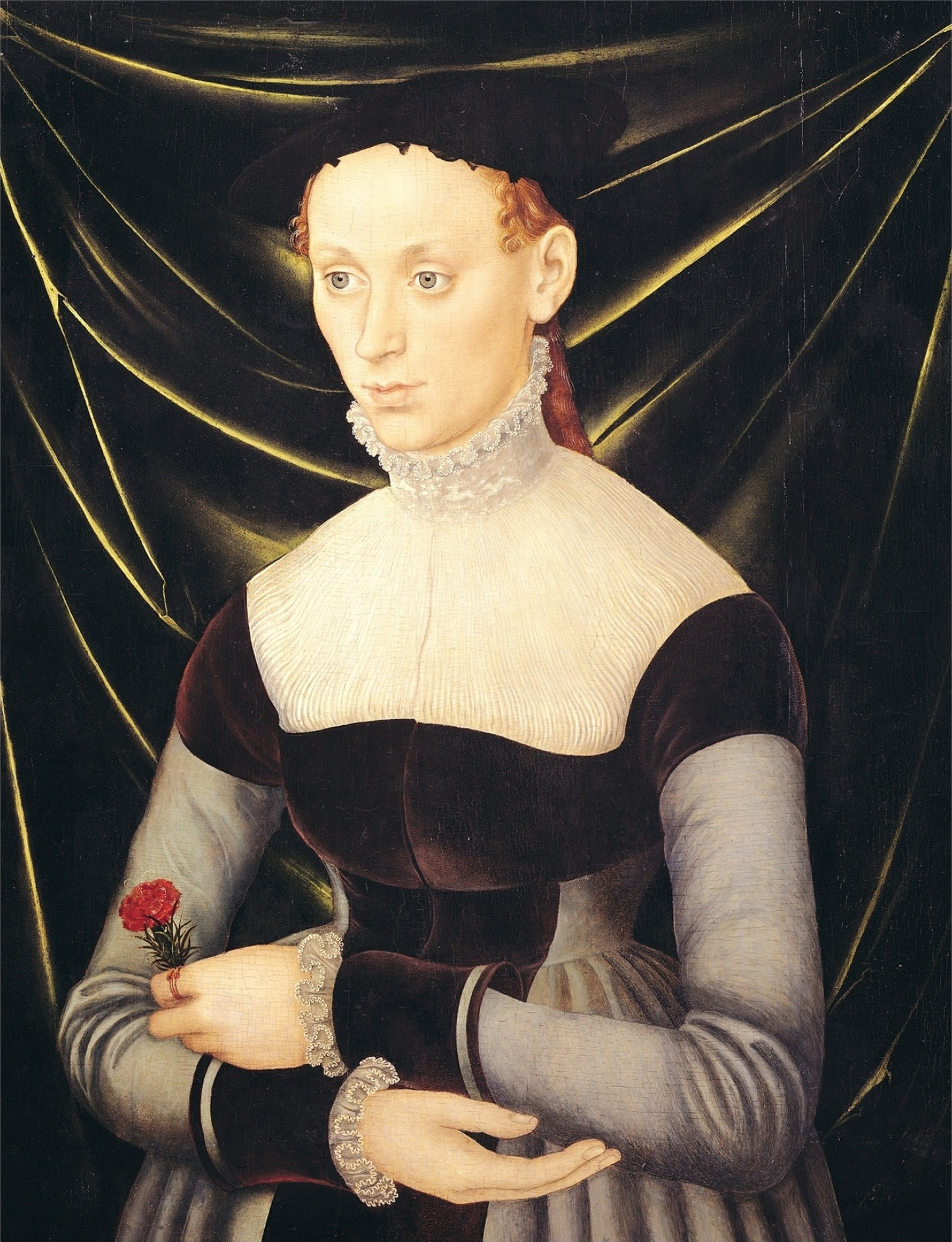 German school, 16th century Formerly attributed to Lucas Cranach the Elder  (1472–1553). Woman with a Carnation, 16th century